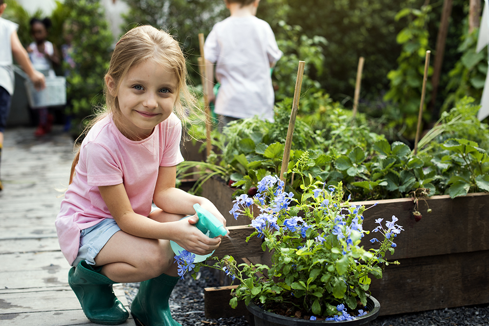 Kid in a garden at a preschool & Daycare Childcare Center serving Thornton, CO