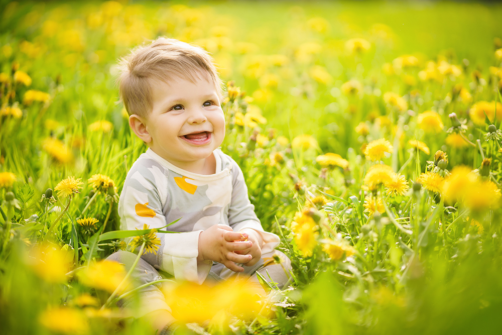 brown-eyed baby playing outdoor at a preschool & Daycare/Childcare Center serving Thornton, CO