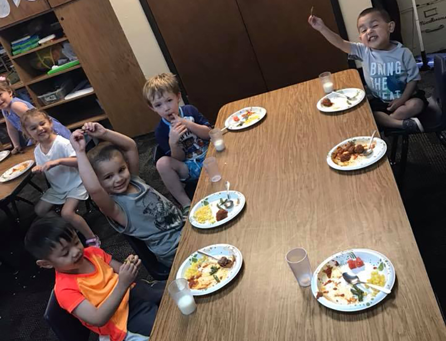 happy children eating at a Preschool & Daycare Serving Thornton, CO