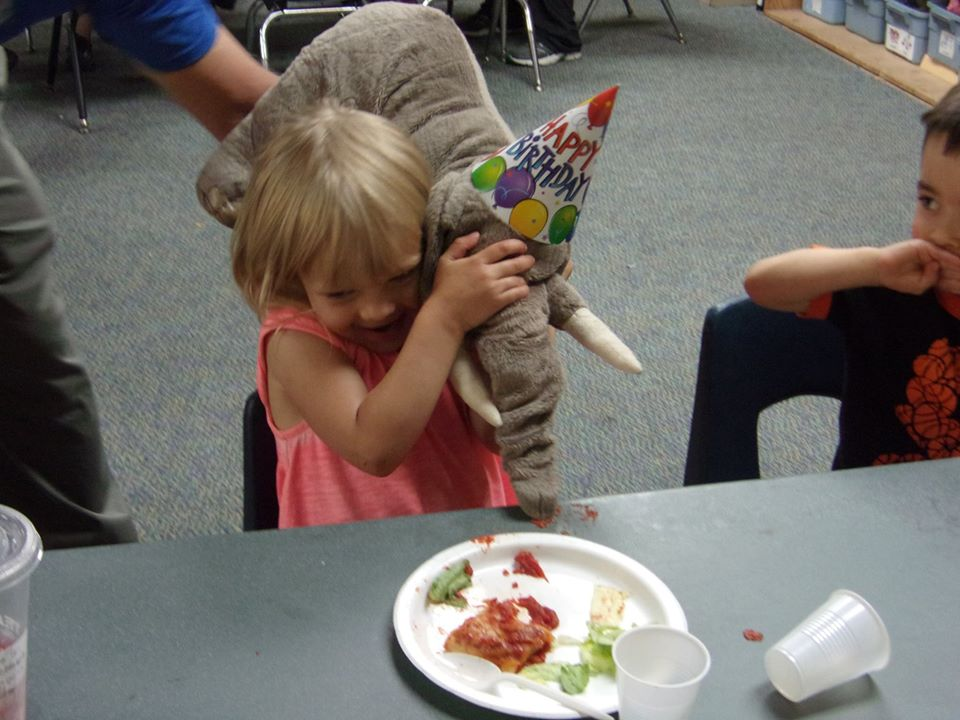 laughing girl eating in class at a Preschool & Daycare Serving Thornton, CO