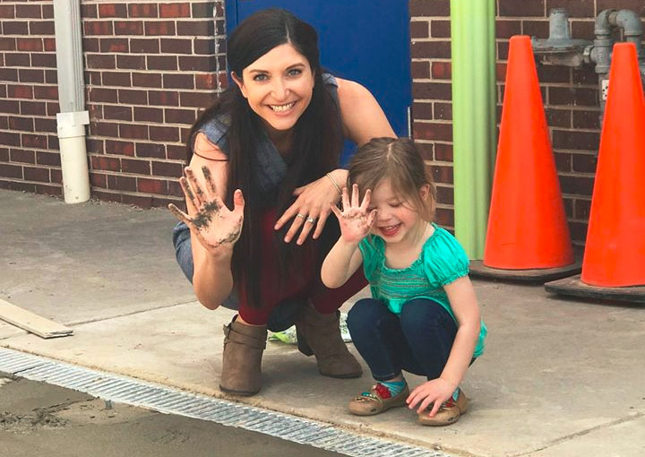 smiling teacher and toddler waving at a Preschool & Daycare Serving Thornton, CO San Antonio, TX
