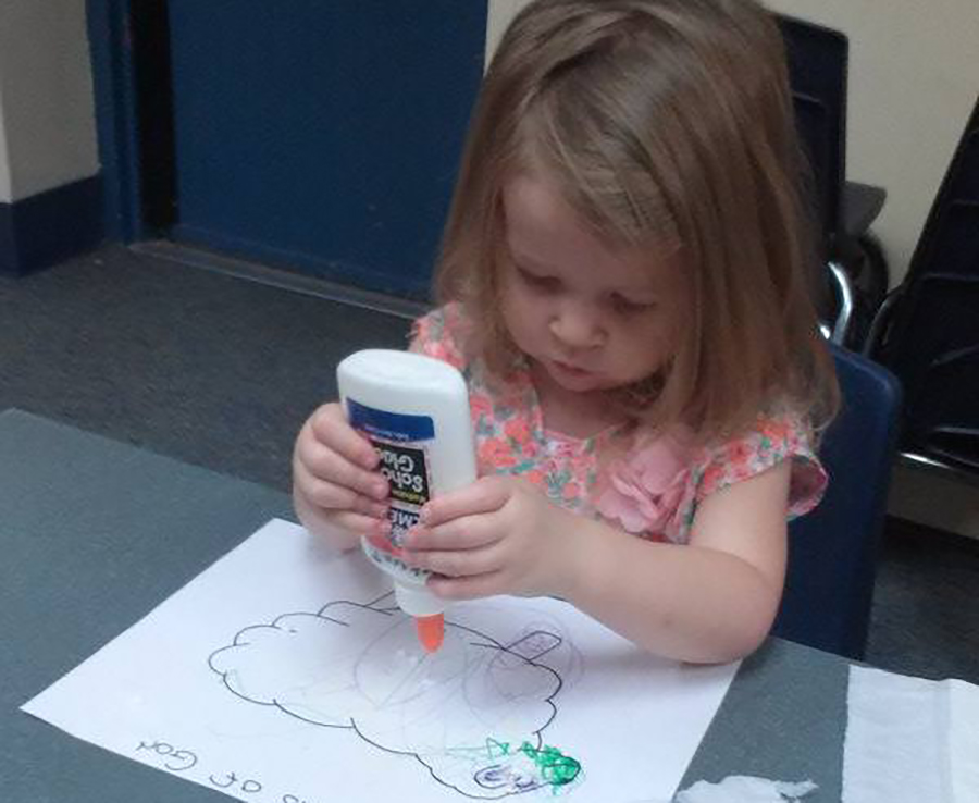 young girl doing arts and crafts at a Preschool & Daycare Serving Thornton, CO