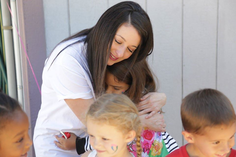 teacher hugging kids at a Preschool & Daycare Serving Thornton, CO